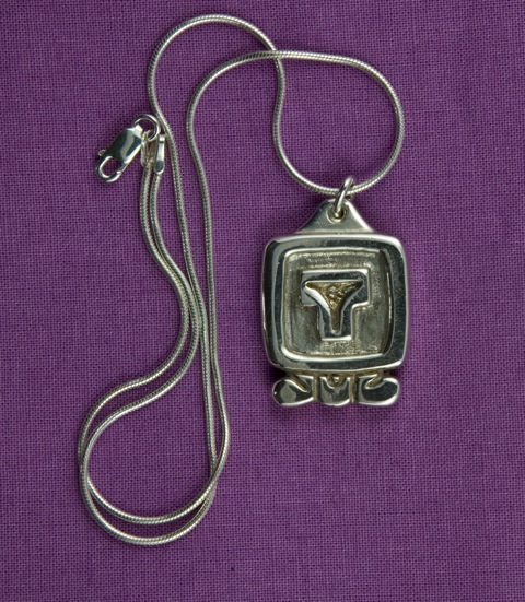 Sterling Silver Ik' daysign pendant with carved symbol and edge